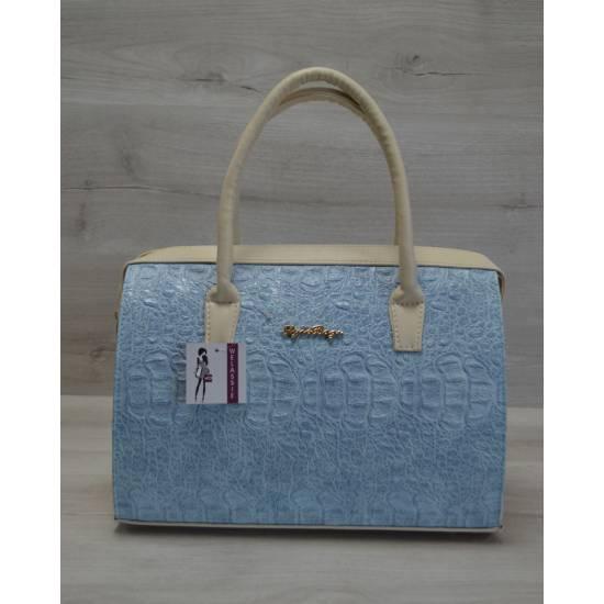 Каркасная женская сумка голубого цвета с бежевыми ручками