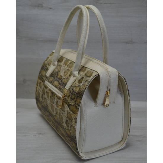 Каркасная женская сумка золотого цвета с бежевыми ручками