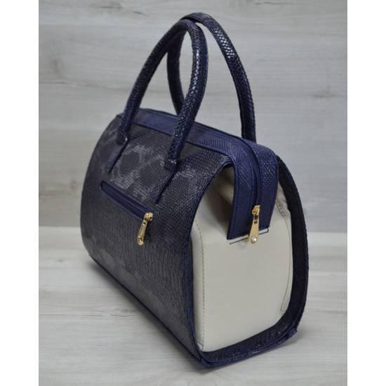 Каркасная женская сумка синего цвета