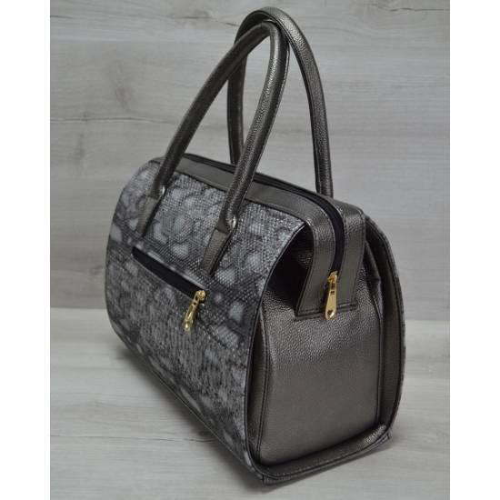 Каркасная женская сумка цвета металлик