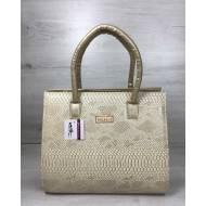 Женская каркасная сумка золотого цвета со вставкой