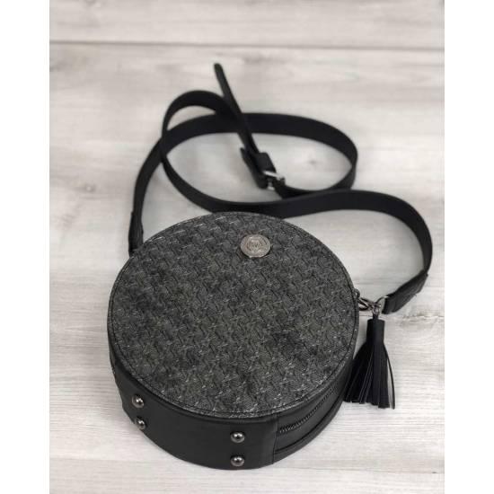 Стильная женская сумка черного цвета со вставкой серебряного цвета
