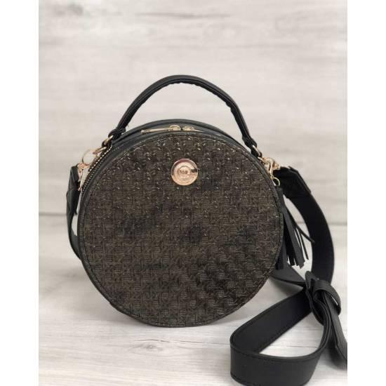 Стильная женская сумка черного цвета со вставкой золотого цвета