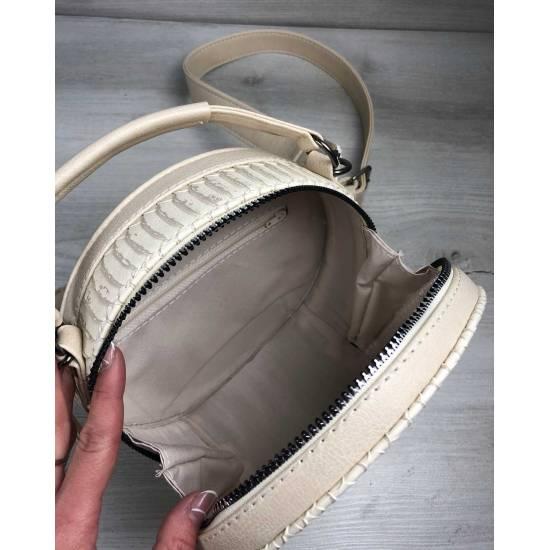 Стильная женская сумка бежевого цвета