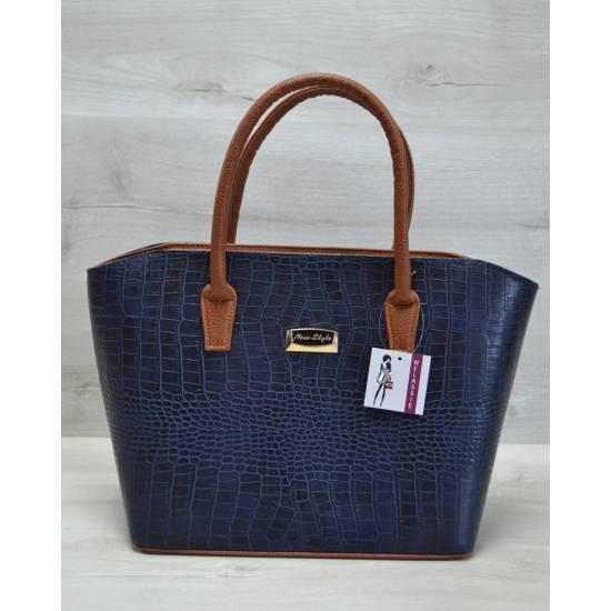 Стильная сумочка синего цвета с ручками рыжего цвета