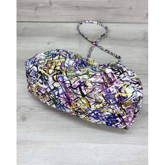 Модная женская сумочка разноцветного цвета с узорами