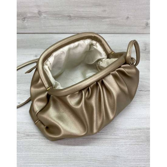 Модная женская сумочка золотистого цвета