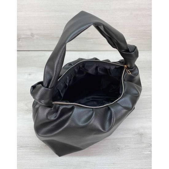 Стильная сумочка из экокожи черного цвета