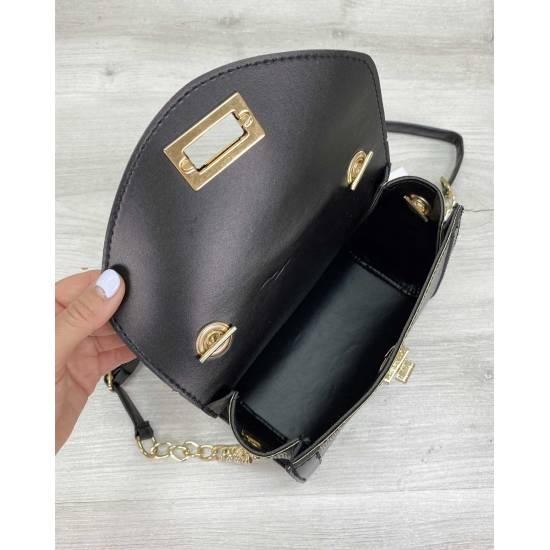 Женская сумочка золотистого цвета
