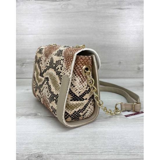 Женская сумка бежевого цвета леопардовой расцветки