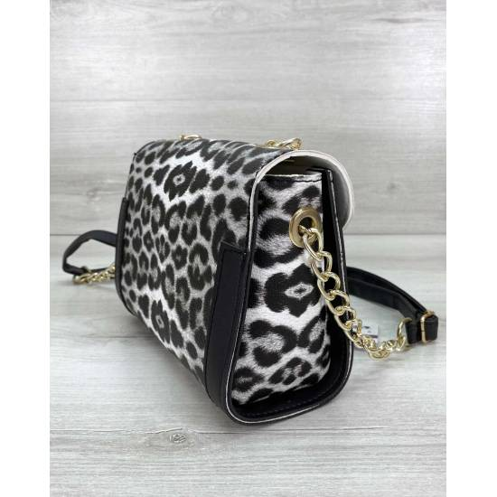 Модная женская сумочка черно-белого цвета леопардовой расцветки