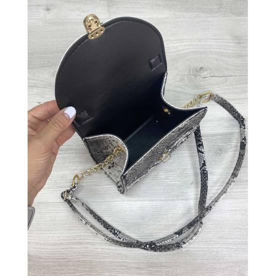Модная женская сумочка черно-белого цвета с узорами
