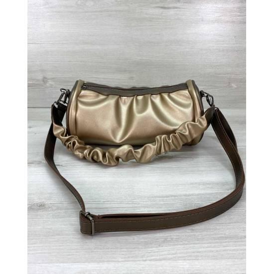 Стильная сумка золотистого цвета