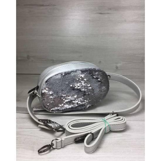 Женская сумка серебряного цвета на пояс