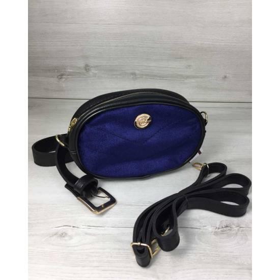 Женская сумка синего цвета на пояс