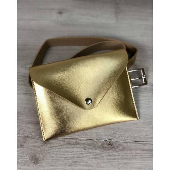 Женская сумка золотого цвета на пояс
