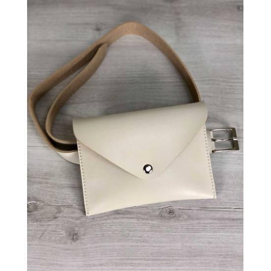 Женская сумка бежевого цвета на пояс