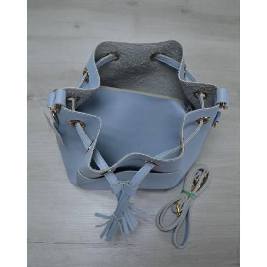 Модная сумочка голубого цвета с клатчем