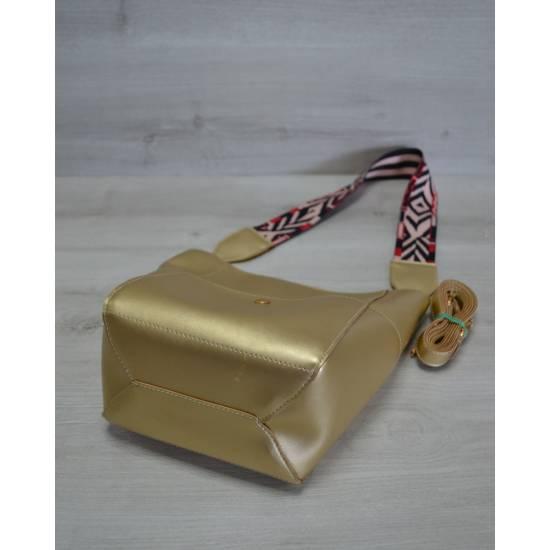 Золотистая сумка с клатчем и ярким ремнем