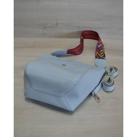 Стильная сумочка голубого цвета с клатчем
